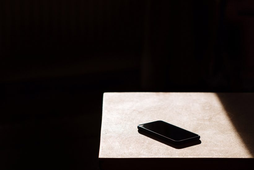 Close-Up Of Mobile Phone In Darkroom