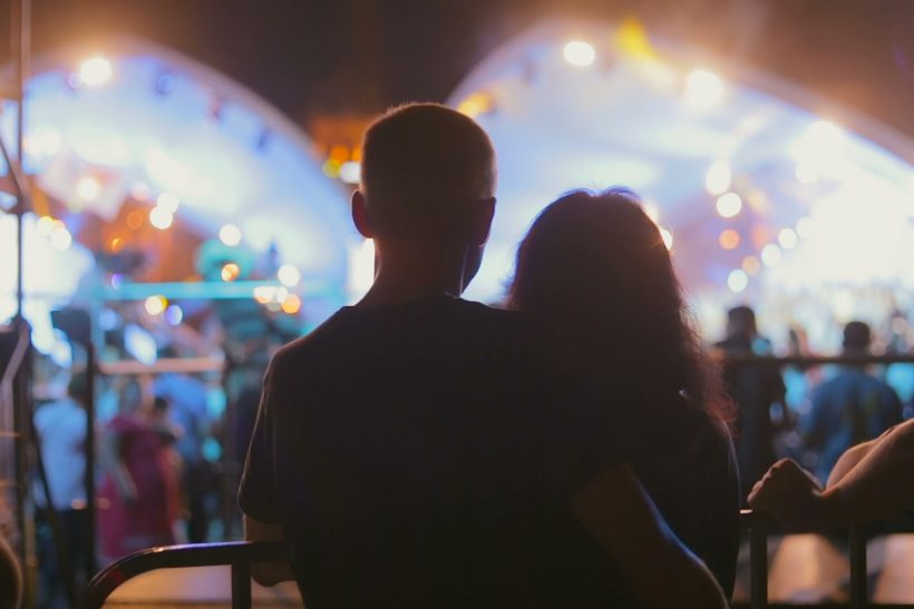 silhouettes-couple-love-hugging-concert-footage-071594297_prevstill